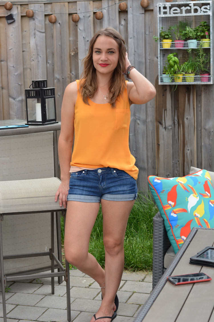 orange shirt jean shorts